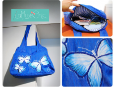 Geanta pictata manual cu fluturi pe textil albastru